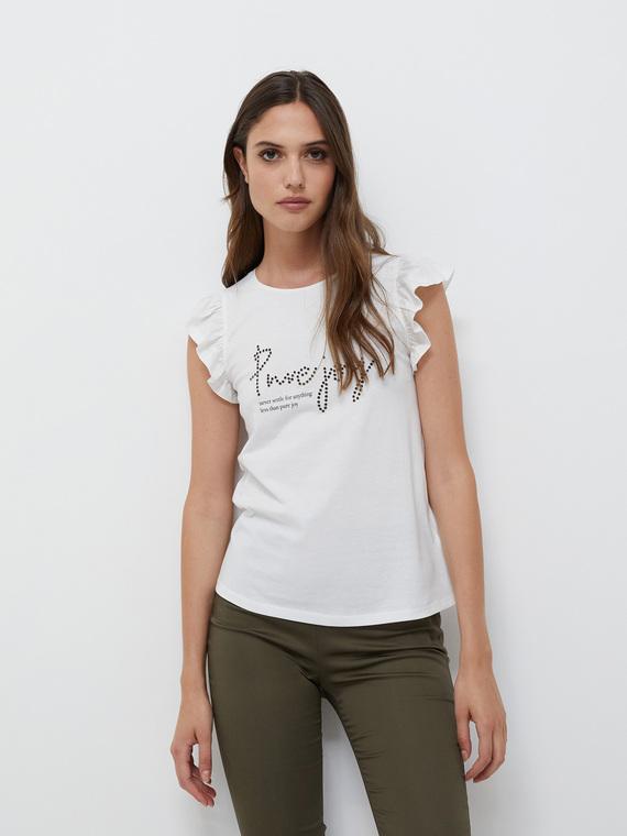 T-shirt in jersey 100% cotone; scollo tondo e maniche corte a volant; scritta frontale con applicazione di borchie.